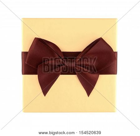 Top view of yellow gift box with brown ribbon and bow isolated on white background