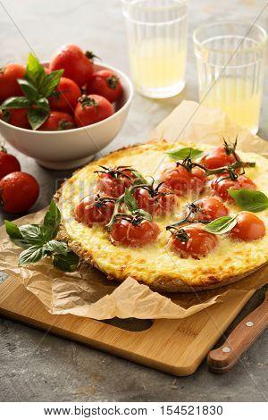 Savory rustic cheese tart with cherry tomatoes