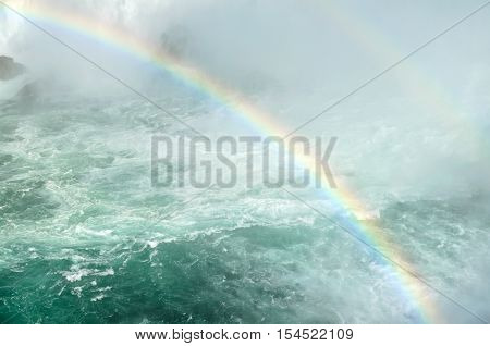 Double rainbow across river and waterfall - natural background