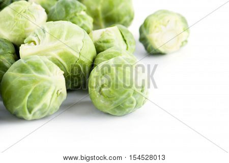 Fresh ripe brussels sprouts isolated on white background