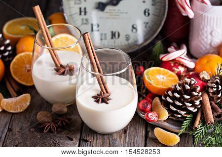 Eggnog with cinnamon for Christmas in a rustic setting