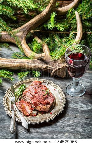 Fresh Piece Of Venison Served With Red Wine