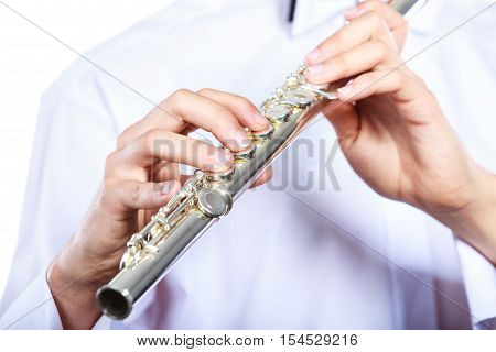 Hands Of Young Man Playing The Flute