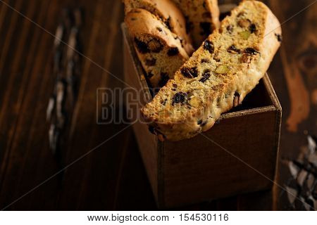 Homemade biscotti with dried fruits and nuts in a box