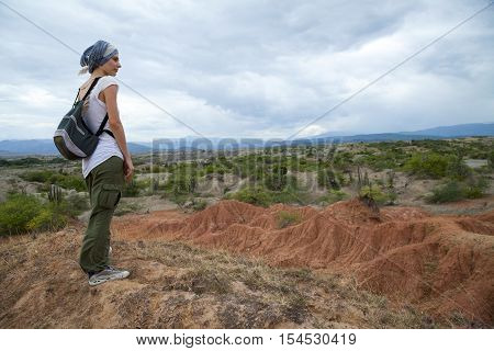 Female traveler overlooking Tatacoa desert during the day