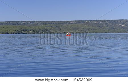 Canoeing on a Shoshone Lake in Yellowstone National Park in Wyoming
