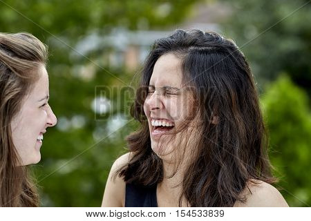 Two Girls Laughing Together