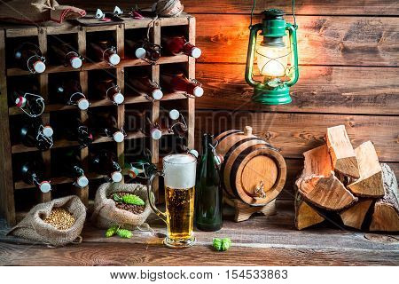 Homemade beer storeroom in the cellar on old wooden table