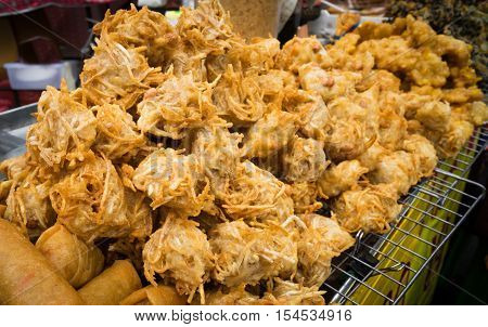 a street market food called fried taro root with bean inside