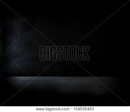 Dark black room. Dark concrete wall and floor.