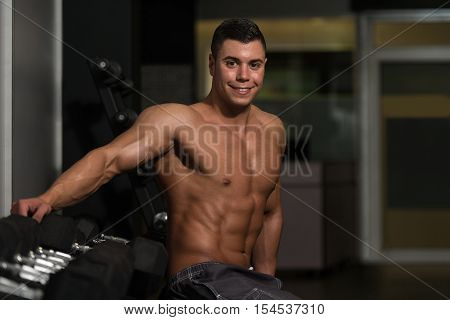 Attractive Young Man Resting In Gym Afther Exercise