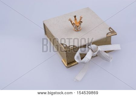 Book Model And Golden Color Crown Model