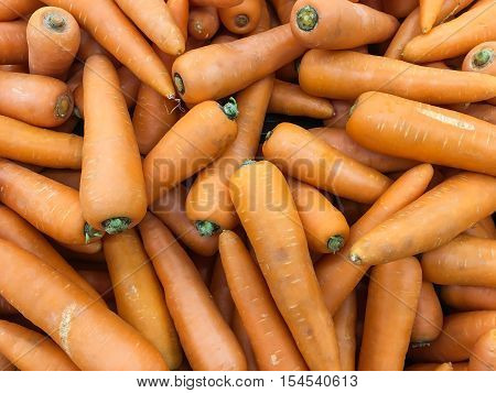 Heap of farm grown carrot. These carrot grown in northern Thailand. These carrot are cheaper than imported carrot. But imported carrot tent to be bigger. Thai like to add carrot to their local menu.