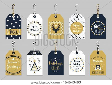 Golden and dark navy blue Christmas and Holiday gift tags set on trendy gray background
