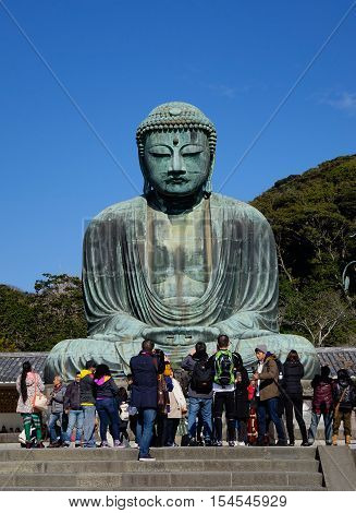 Great Amida Buddha And Tourists In Japan