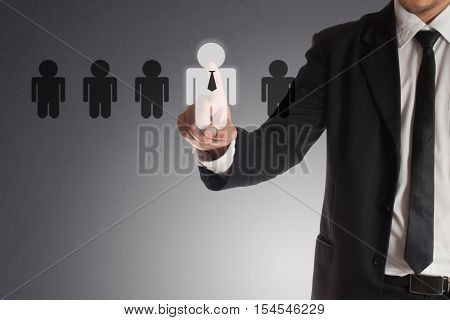 businessman choosing right partner from many candidates Concept of teamwork.