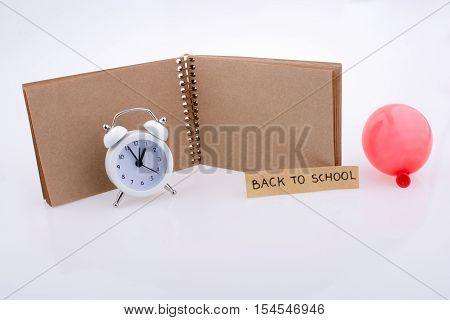 Note Book, Balloon  And An Alarm Clock