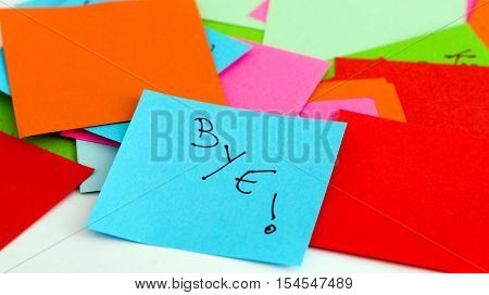 picture of a Note papers on white backgroundtext bye
