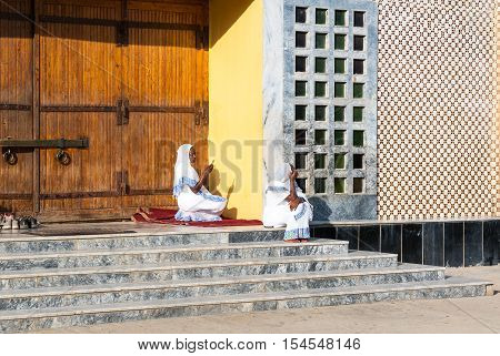 Axum Ethiopia - January 20 2016: Faithfuls sitting on the stairs of the modern church of Our Lady Mary of Sion