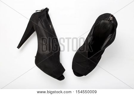 Women's suede shoes on white background top view.