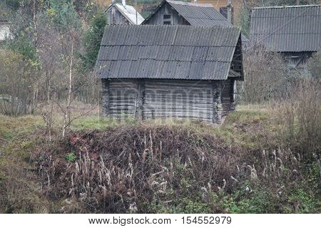 building in  retro style from wood logs bathhouse on the bank of the river