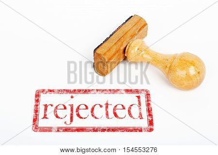 office rubber stamp with rejected stamp on white paper