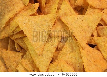 Background Of Yellow Tortillas Chips With A Lot Of Salt