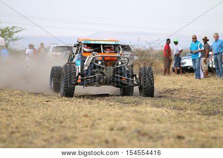Speeding Orange Zarco Rally Car At Start Of Race