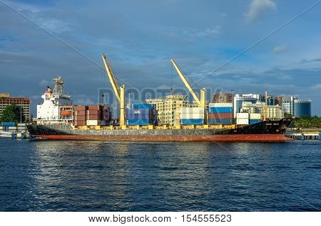 Labuan,Malaysia-Oct 25,2012:Container vessel unloaded in Labuan port at Labuan island,Malaysia.Its a sheltered deep-water harbour which is an important transshipment point for Brunei Darussalam,Sarawak & Sabah.
