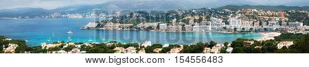 Beautiful panoramic view from above of Santa Ponsa resort the beach with white sand sunbeds hotels and yachts Mallorca