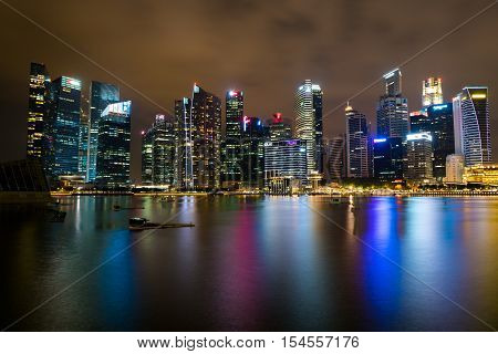 SINGAPORE - 1 OCTOBER 2016: View of Singapore skyline and Marina bay at night with reflection in water