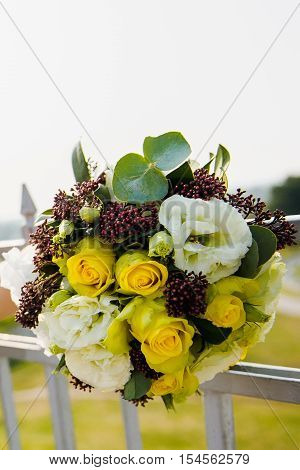Beautifuly decorated wedding reception table covered with fresh flowers. Beautifuly decorated wedding reception table covered with fresh flowers