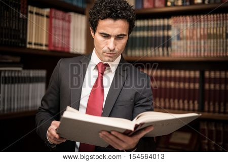 Lawyer reading a book in his studio