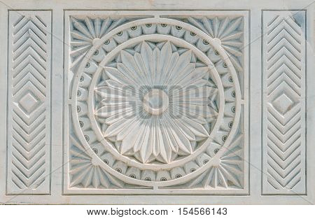 Beautiful stonework engraved tile with double circle and floral motif at its center