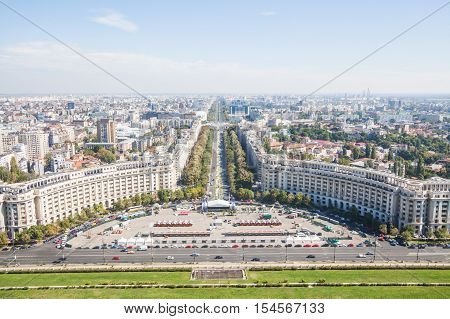 Bucharest Romania - October 1 2016: High angle view of Unirii Boulevard and Constitutiei square in Bucharest Romania.