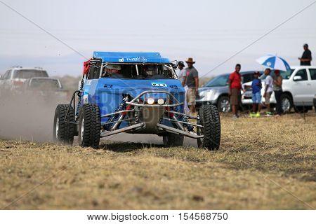 Speeding Blue Zarco Rally Car Front View