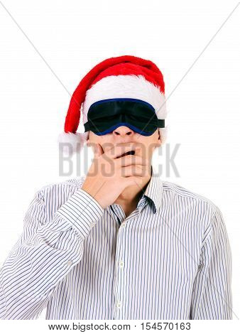 Young Man in Eye Mask and Santa Hat Isolated on the White Background