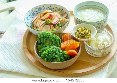 Healthy meal with broccoli, potato and congee