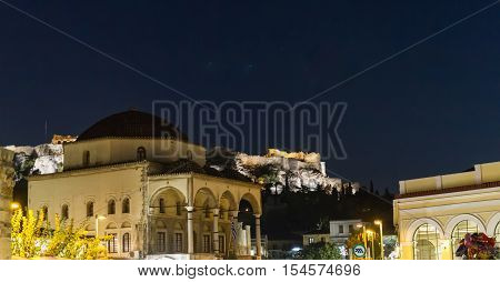 Evening view of the Acropolis monument from Monastiraki Square in Athens Greece