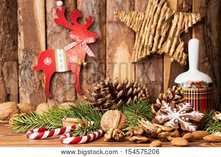 Christmas Decorations. Gingerbread Cookies, Walnuts, Christmas Bell, Fir Tree  Branch