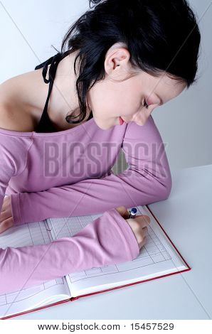 young student girl writing in diary