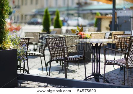 Empty Chiars In Outdoor Cafe On Summer Day