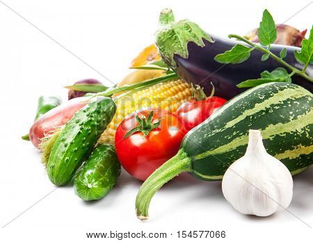 Fresh vegetable with green leaves and herbs. Isolated on white background