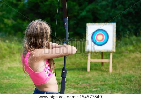 Girl Teenager With Bow Nock And Aims To Target