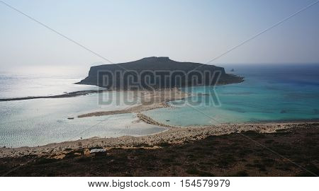 Cove Bay sea ocean view from the mountains down in the evening haze mist on the water view blue green turquoise aquamarine color, mountain, island, sandy spit