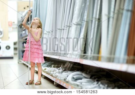 Adorable Girl In A Houseware Store