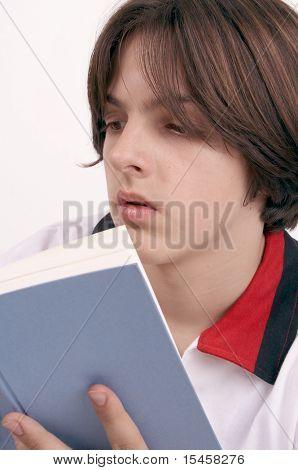 boy reads interesting book