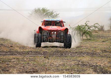 Front View Close-up Of Racing Orange Bat Rally Car