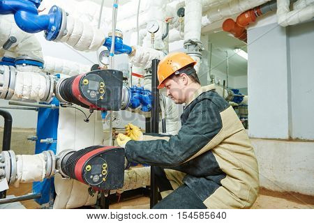 Plumber technician works with water pump