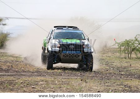 Front View Close-up Of Racing Green And White Toyota Hilux Twin Cab Rally Car
